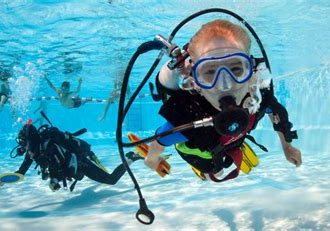 photo of scuba divers in a pool